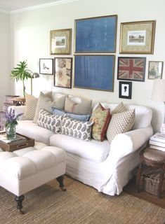 Holly Mathis living room gallery wall - and my husband thinks I like pillows - look at all those sofa pillows!