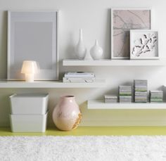Floating white shelves from ikea, use under wall mounted TV, for cable box etc,  instead of a table.