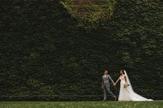 The lovely couple with a lush backdrop in St James Park