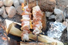 Cook bacon skewers over the campfire.   39 Brilliant Camping Hacks To Try On Your Next Trip