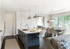 White kitchen with blue island Kitchen features white perimeter cabinets and a blue kitchen island