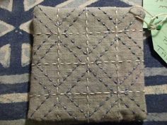 Sashiko in two colors, two layers, restricted palette.