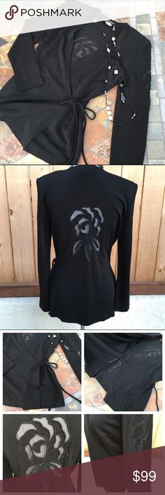 "🆕Beautiful Long Sleeve Top This is one beautiful long sleeve top. Can be worn as second layer or by itself. Wraps & ties inside on right & outside on left. Embroidered flower on both sleeves & back. Additional flower material is sheer. Measurements are 17.75"" pit to pit & 27"" from shoulder seam to bottom of top. Content is 82% Rayon, 10% Nylon & 7% Lycra. Excellent condition with NO damage. Nicole Bakti Tops"