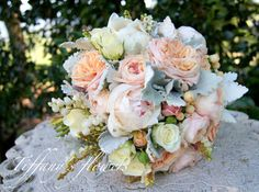 Gorgeous David Austin roses, peonies & dusty miller bridal bouquet designed by Tiffany's flowers
