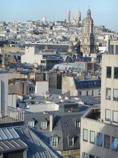 """Outside on the rooftop of the Dpt. store """"Printemps"""", you can enjoy a latte while enjoying the panoramic view of Paris.   ....En haut au magasin du Printemps, coin du Havre et Blvd. Haussmann, vous pouvez apprécier un Latté et voyez la trés belle vue de Paris!  Ici dans la distance, La Basilique du Sacré Coeur de Montmartre.  ....arrondissement 9..."""