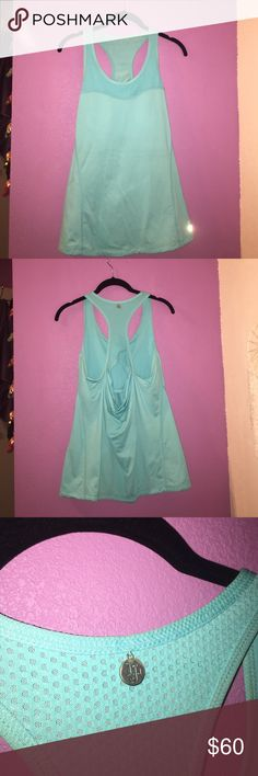 LORNA JANE TANK TOP Lorna Jane workout Tank Top with built in sports bra. Only worn a few times but looks brand new. Let me know if you have any questions or want me to do a try on! Honestly just trying to get rid of stuff in my closet make me an offer! :) comes from a smoke free and let free home Lorna Jane Tops Tank Tops