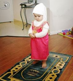 Cute Muslim child in praying outfit
