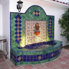 Wall fountain with lights using Mexican tiles by kristiblackdesigns.com