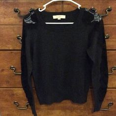 Dark grey LOFT sweater Dark grey LOFT sweater with black lace on the sleeves. No flaws. Very clean. Size M. LOFT Sweaters Crew & Scoop Necks