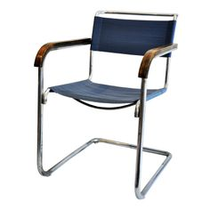 Marcel Breuer armchair by Thonet. Breuer, an architect and furniture designer, was a student and later teacher at the Bauhaus. He is credited with creating the first cantilevered chair and was a pioneer in tubular-steel furniture. A simple, modern, and functional chair, designed in Germany, 1928.  [Bauhaus]