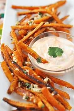 Sweet potato fries with parmesan, cilantro, and skinny sriracha sour cream