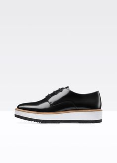 A sport-luxe update of the classic black leather oxford, this menswear-inspired style arrives in high-shine Italian Abrasivato leather with a 2-tone rubber sole that makes it incredibly lightweight and comfortable. An almond  toe lends a feminine polish to  its streamlined shape. The sole is  finished with tread for  durability and a natural raw leather trim for an artisanal touch.