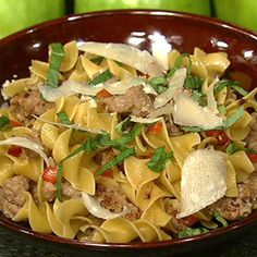 1 pound Ground Italian sausage2 Red Bell Peppers (diced)1 pound Egg Noodles1/4 cup Basil (chiffonade)Parmesan (to garnish)2 tablespoons Olive Oil2 tablespons Butter