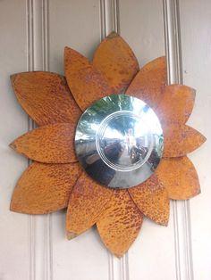 Hudson hubcap flower rusted metal wall hanger
