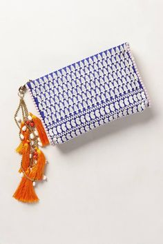 Bold blue and orange clutch. The tassels and white pattern create a really nice bohemian/moroccan vibe.