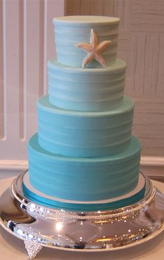 Blue ombre round tiered wedding cake with a single starfish accent