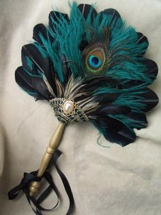 Love the way this fan gets across the peacock feel with just one actual peacock feather.