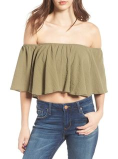off the shoulder crop top by Moon River. Show off your feminine side, and a little skin, in this flouncy cotton top that ups the flirt factor with an off-the-...