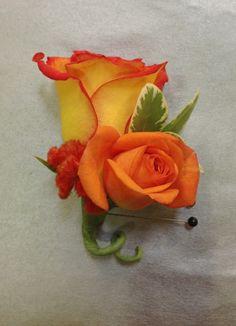 Orange and yellow rose groom's boutonniere closeup. Boutonniere by Seasonal Celebrations. http://www.seasonalcelebrations.com