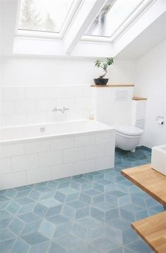 Looking to re-tile your kitchen or bathroom? Try a funky geometric tile! This falling block tile design is on-trend around the world. For more ways to add graphic pattern and punchy prints to your…More #WhiteBathrooms
