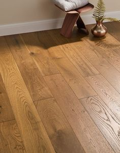 Manhattan Smoked Oak is an engineered wood floor with character and graceful elegance, a wonderful combination that ma Oak Laminate Flooring, Engineered Wood Floors, Wooden Flooring, Manhattan, Wooden Bookcase, Kitchen Cabinet Styles, Bedroom Flooring, Bedroom Rugs, Into The Woods