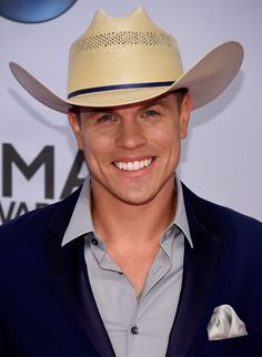 Dustin Lynch attends the 48th annual CMA Awards at the Bridgestone Arena on November 5, 2014 in Nashville, Tennessee.