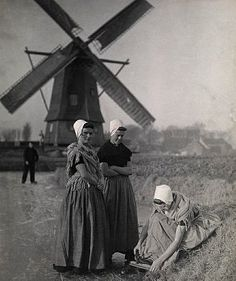 Historical costumes from Walcheren & windmill, Zeeland, the Netherlands