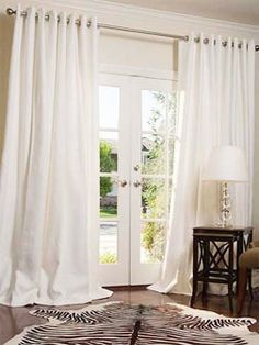 """ATLA reader Karyn wants to know about any personal recommendations for curtain installation: """"I have French doors and I would like to have curtains for them like the ones below. However, what I really want is for someone to come to my house, measure the space, figure out how to make it look most excellent, order the curtains, and come back and install them, rod and all. Does anyone know of a place like this?"""""""