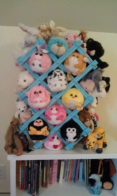 A coat of bright paint and an old wine rack is repurposed as storage/display for stuffed animals.