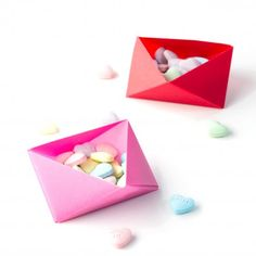 Learn how to make these easy origami boxes. They're perfect for holding Valentine's Day Candies! Click through for the tutorial.