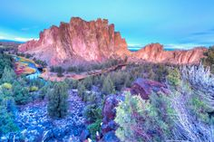 Smith Rock State Park is a state park located in central Oregon's high desert near the towns of Redmond and Terrebonne. Its sheer cliffs of tuff and basalt are ideal for rock climbing of all difficulty levels. Smith Rock is generally considered the birthplace of modern American sport climbing, and is host to cutting-edge climbing routes. It has over a thousand climbing routes, many advanced. Some areas are bolted.[2] The park contains the first U.S. climb rated 5.14 (extremely challenging...