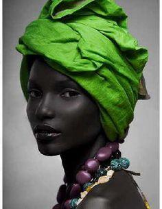 beautiful black model in green headrap