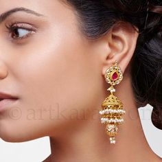 If they had stopped at the second tier jhumka and took out the ball, but left the teeny dangling bunch of pearls, it would've been so perfect. Purva Earring