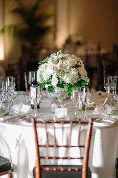 traditional low round white hydrangea and rose table centrepiece arrangement