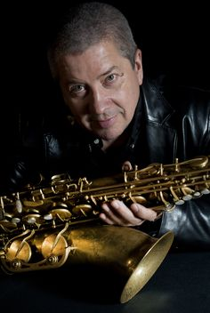 Andy Sheppard Biography - Sheppard has worked with an astonishing range of musical partners. Such as Carla Bley, George Russell and Gil Evans. Gateshead Millennium Bridge, Saxophone Quartet, Gil Evans, John Martyn, Glastonbury Somerset, Young Vic, Norwich Cathedral, Contemporary Jazz