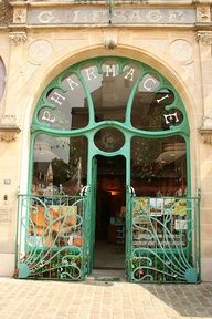This Pharmacy was built in 1901.   It was built for by Georges Lesage, and designed by the architect Caen Rouvray.  Rouvray was a proponent of Art Nouveau in France. Address: Rue General De gaulle