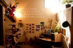Now that is a Reggio-Inspired science area, there is so much to explore and no space is wasted! Lovely warm light, not fluero.
