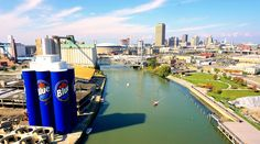 The Labatt's Blue bottles gracing an old façade of grain mills with Buffalo as the backdrop