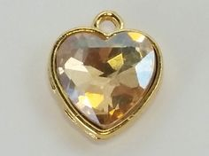 Beads One - Glass Pendant heart 04 Lt Topaz, $0.65  #beading #supplies wholesale jewelry making #link #glass #beads (http://www.beadsone.com/links-and-connectors/beads-glass-pendant-heart-04-lt-topaz.html)