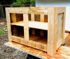 Cabinet taking shape, constructed from repurposed wood pallet lumber.