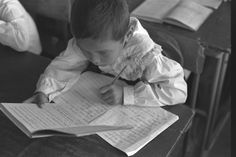 Vintage UNICEF! A girl completes an exercise from her lesson book in a classroom at a UNICEF-supplied school in Uzbekistan's Bazatau district, in 1997. © UNICEF/NYHQ1997-0505/Murray-Lee