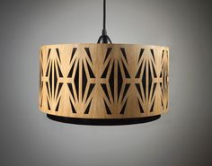 Lampshade made of wood with cut-outs / Handmade. €249.00, via Etsy.  GORGEOUS!