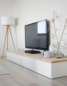 White And Pale Wood Living Room With Makeshift Media Console