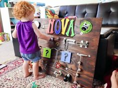 This is an awesome busy board with instructions on how to make it! If you are crafty you could create a similar super sensory board