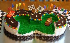 Homemade Cars 3rd Birthday Cake: Making this Cars 3rd Birthday Cake and having this CARS party for my 3 year old son was a blast! It is actually made from 4 round cakes (2 stacked on top