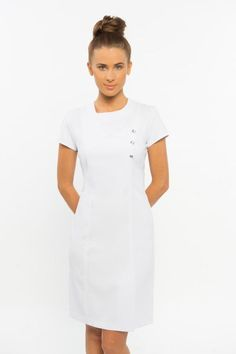 SPA-30 Dress - White. Gorgeous dress which looks professional and is also very comfortable to wear. Zips at rear, no collar. Cap sleeves makes it very easy to work in. Diamonte buttons on front. ( diamonte buttons could be removed if you didn't like them) We do not remove them prior to delivery but they are easy to remove if you wish to) Small split at rear for easy movement. Available in sizes 6-24, View our sizing chart. Available in black or white.