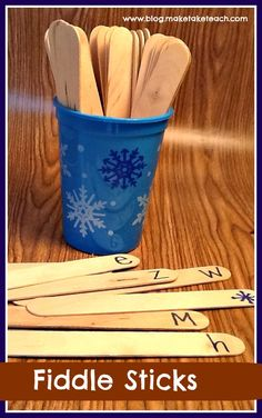 "Fiddlesticks game - write letters on one end of craft sticks.  Add some with a symbol like a dot, sad face, or lightening rod (example uses snowflake to match cup).  Put sticks in cup face down.  Player chooses stick.  If they can name it, the keep it.  If they get a symbol stick, all their sticks go back in the cup.  After a certain time limit, player with most sticks ""wins"""