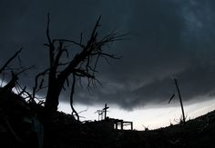 A cross stands atop a church that was severely damaged. (AP Photo/Charlie Riedel) Joplin Tornado May 22, 2011