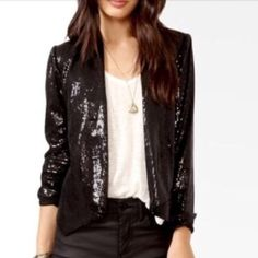 Black Sequins & Faux Leather Blazer/Jacket Back is faux leather. Collar, front & sleeves have sequins. Long Sleeves can be rolled up like in first pic. Fully lined. Faux pockets trimmed with faux leather. Front slightly longer than back for an edgy/modern look. Shoulders are lightly padded Forever 21 Jackets & Coats Blazers
