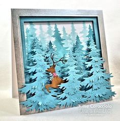 Love the way she used the negative space from the die cut to ink the trees in the background!